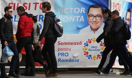 Bucharest, Romania - March 01, 2019: People passes the poster of the pre-electoral campaign of Pro Romania party which calls for signatures for participation in the European Parliamentary elections. Sajtókép