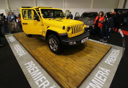 Bucharest, Romania - October 21, 2018: An yellow 2018 Wrangler JK Sahara car is exposed at the Bucharest Auto Show, in Bucharest, Romania. This image is for editorial use only.