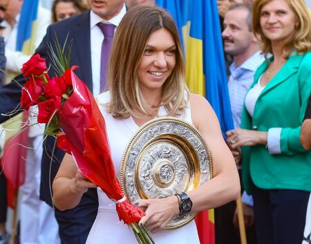 Bucharest, Romania - July 17, 2019: Wimbledon women's singles tennis champion Simona Halep poses with her replica of the Wimbledon trophy at the ceremony organized in her honor at the National Arena.