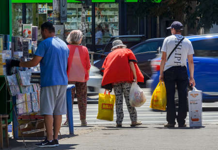 Bucharest, Romania - July 02, 2020 Old people cross the street on crosswalk on a large boulevard in Bucharest. This image is for editorial use only.