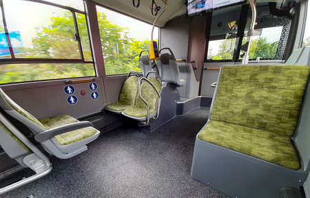 Bucharest, Romania - Juny 13, 2020: Soft upholstered seats in the passenger compartment of a Mercedes Citaro Hybrid bus.