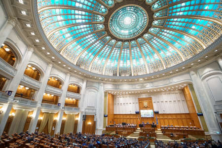 Bucharest, Romania - March 24, 2021: Working meeting of the deputies in the grand plenary hall of the Chamber of Deputies of the Romanian Parliament, in Bucharest, Romania.