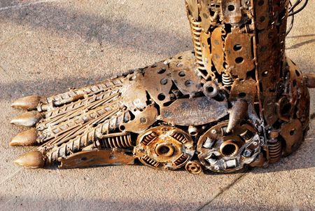 Alien leg made from old spare parts for cars Stock Photo