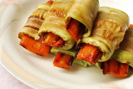 Small vegetable marrow rolls with carrot