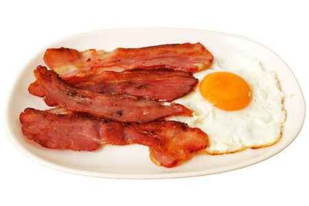 Fried egg with bacon on white plate isolated