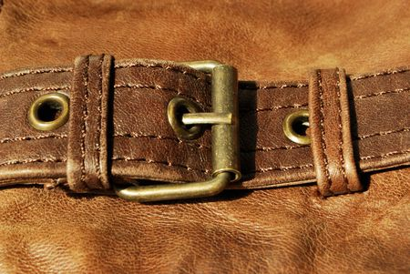 Brown leather with belt fastener (texture, material, background, decoration) Stock Photo