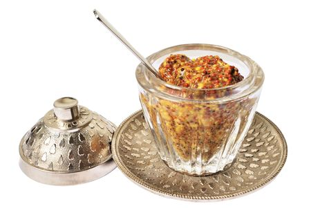 French mustard in transparent glass pot