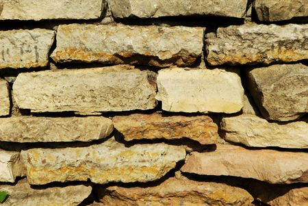 Old weathered stone wall (texture, background, material) Stock Photo