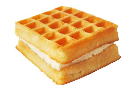 Waffles with milk cream isolated over white