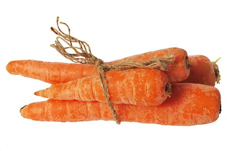 Three carrots tied by string isolated over white