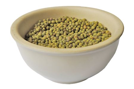 Dry split peas in ceramic bowl isolated over white Stock Photo