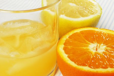 Cut lemon and orange with glass of juice Stock Photo - 5344190