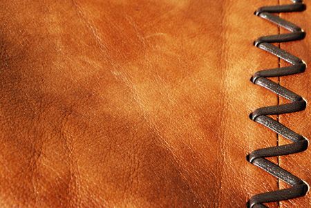 Brown leather decorated by zigzag stitch on right