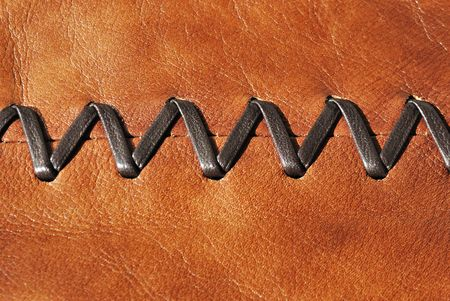 Brown leather decorated by zigzag stitch on center