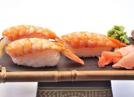 Sushi on ceramic dish on white background