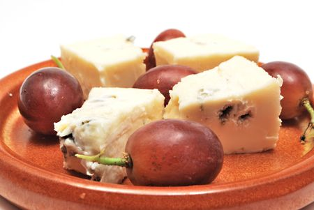 Plate with cheese and grapes on white background Stock Photo