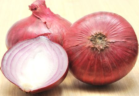 Two and a half onions isolated on white background Stock Photo