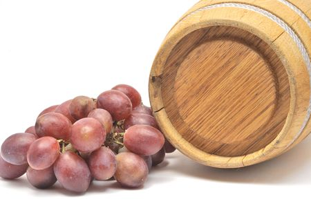 Small wine barrel and grapes isolated on white Stock Photo