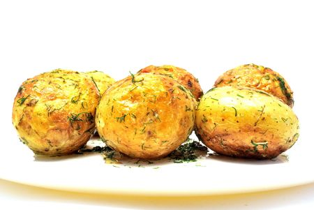 Fried whole potatoes with dill and garlic Stock Photo