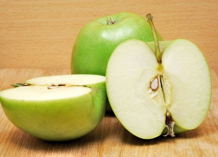 Fresh juicy green apples on wood kitchen table Stock Photo