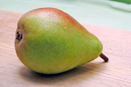 Fresh ripe pear on wood kitchen board