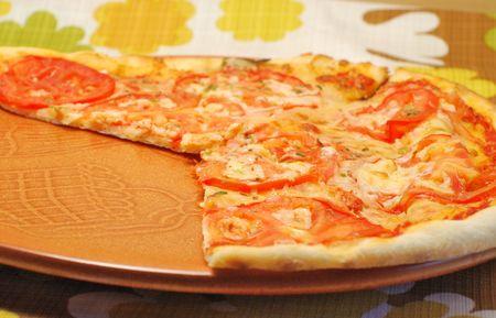 Pizza neapolitana on brown ceramic plate