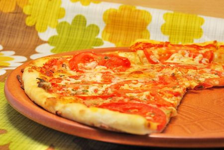 Pizza neapolitana on brown ceramic plate