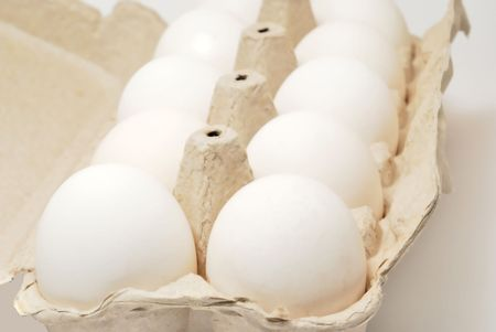 Eggs in container on white background Stock Photo