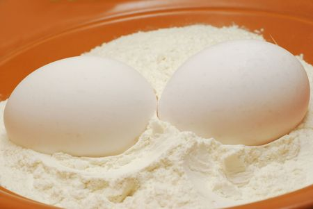 Whole eggs with flour in brown cup