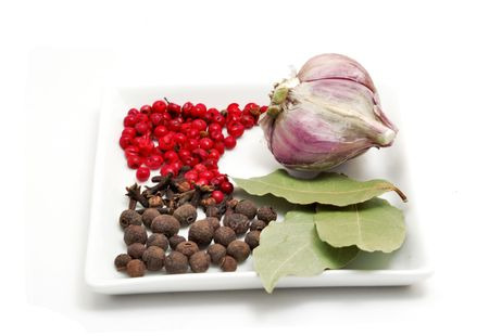 Red pepper, cloves, bay leafs and garlic isolated on white background Stock Photo