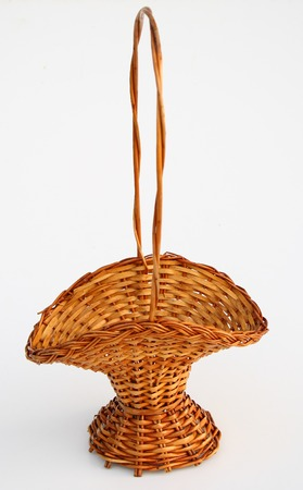 wicker work: straw basket old isolated on white background