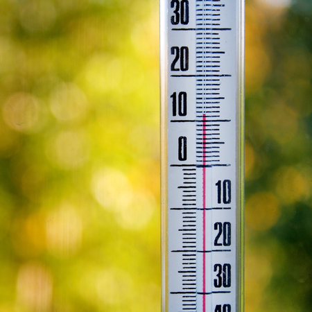 celcius: a thermometer to measure the temperature of the weather macro photo Stock Photo