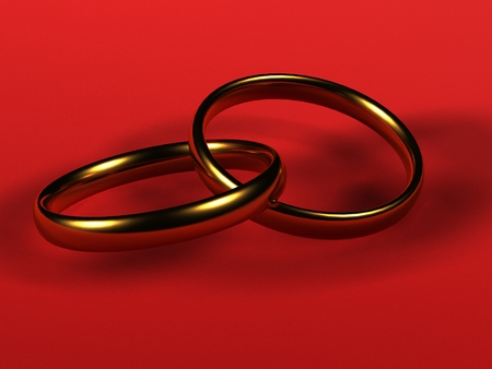 intertwined: Two gold wedding rings