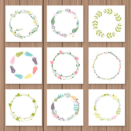 Set with floral wreaths. Template for wedding, mothers day, birthday, invitations on a wood background.
