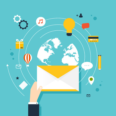 oncept: Marceting �oncept of running email campaign, email advertising, direct digital marketing. Human hand holding an envelope spreading information.