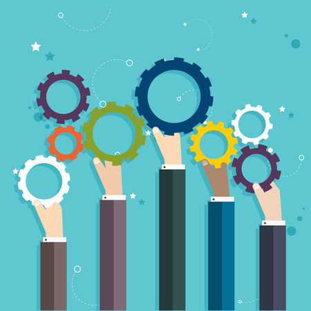 merging together: Concept of teamwork and integration with businessman holding colorful cogwheel