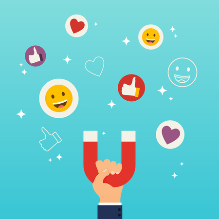 Social media marketing concept. Hand holding magnet attracting likes, hearts and reaction smileys.