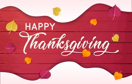 Happy Thanksgiving text with  leaves over red wood background.