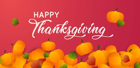 Happy Thanksgiving text with pumpkins and leaves over dark  background.