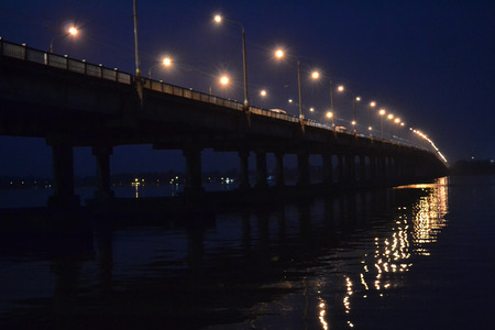 dnieper: Central Bridge, the bridge across the Dnieper, Dnieper River, a large river, car ferry, night bridge, right bank, left bank, road bridge, in Dnepropetrovsk, dirty water, muddy water, the bridge of Ukraine, a huge structure, complex structure, Dnepropetrov Editorial