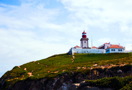 The lighthouse of Cabo da Roca, located on a promontory of granite boulders and interspersed limestone and facing the ocean. The westernmost part of Portugal is the municipality of Sintra.