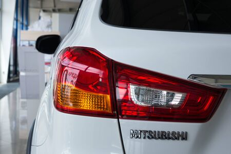 Ukraine, Cherkasy, May 2019. Rear light of a modern white car brand Mitsubishi. Close-up. Detail of automotive lighting system. Sajtókép