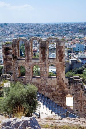 Ancient stone theater with marble steps of Odeon of Herodes Atticus on the southern slope of the Acropolis. Athens, Greece. The Odeon is the main scene of the Athenian festival.