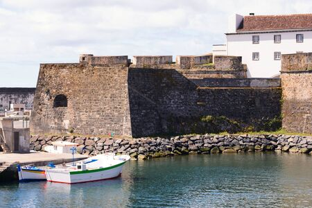 Ships, boats and boats in the port of Ponta Delgada in the area of the old Portuguese fort of St. Blasius. Island of San Miguel.