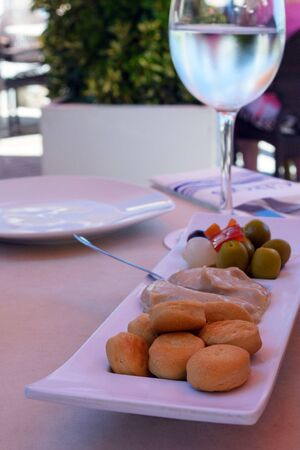 Crispy, salty, nutritious cookies. Traditional appetizer on the island of Mallorca, Spain. Galletas Quelitas on a white plate in a Spanish restaurant in the city of Palma Nova.