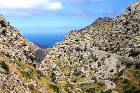The winding famous road on the island of Mallorca, Spain. Serpentine Dangerous Road in Sa Calobra. 스톡 콘텐츠 - 131958452