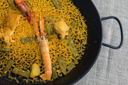 Traditional Valencian cuisine. The national Spanish dish of Valencia is Paella Valencia. Tasty lunch in a Spanish restaurant. Close-up. 版權商用圖片