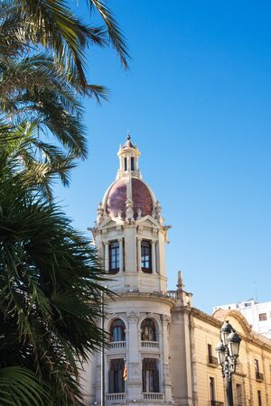 The beautiful town hall rises in Piazza Ayuntamiento de Valencia on a bright sunny day. Valencia, Spain. The trip.
