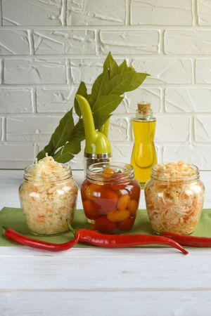 Fermented foods. Sauerkraut, salted tomatoes on a white background. Vegetarian food.