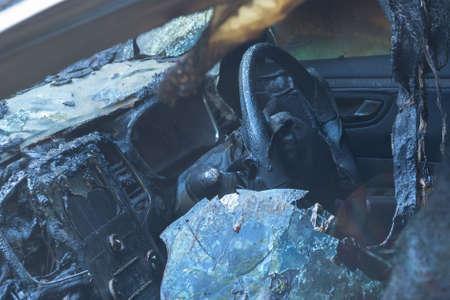 Burnt-out passenger car. Burnt car interior close-up. Fire in the car. Danger. Banco de Imagens